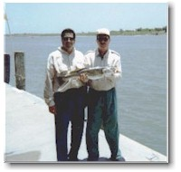 This 8-pound, 10-ounce speckled trout won Mike Sims a brand new boat and trailer package.